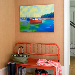 Example of a classic entryway design in Portland Maine with orange walls