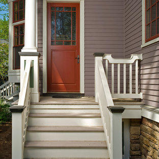 Inspiration for a mid-sized timeless light wood floor entryway remodel in New York with purple walls and a red front door