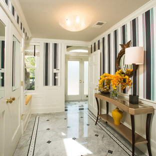 Example of a mid-sized transitional marble floor and gray floor entryway design in DC Metro with a white front door