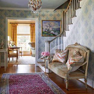 Design ideas for a mid-sized traditional foyer in Charlotte with medium hardwood floors and multi-coloured walls.