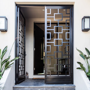 This is an example of a contemporary front door in Melbourne with a double front door and a metal front door.