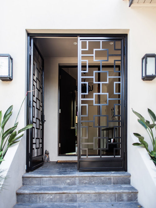 Example Of A Trendy Entryway Design In Melbourne With A Metal Front Door