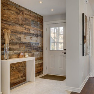 Entryway - small contemporary porcelain floor and white floor entryway idea in Montreal with gray walls and a white front door