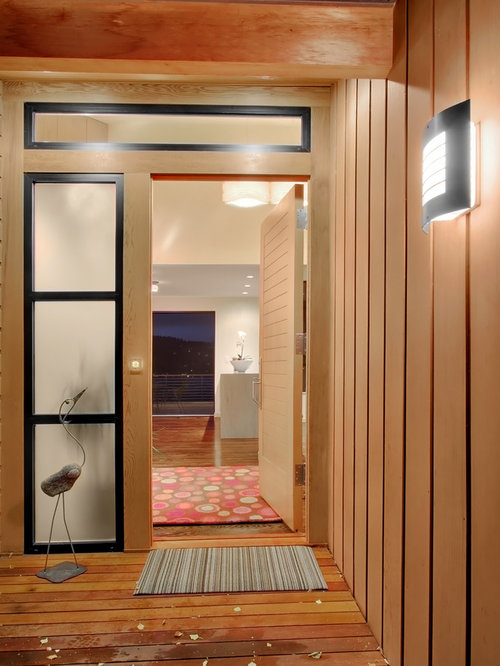 Example Of A Trendy Entryway Design In Seattle With A Medium Wood Front Door