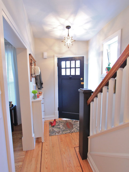 Example Of A Small Eclectic Light Wood Floor Entryway Design In Toronto  With A Blue Front
