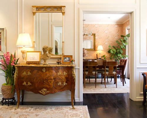 example of a classic entry hall design in los angeles with dark hardwood floors