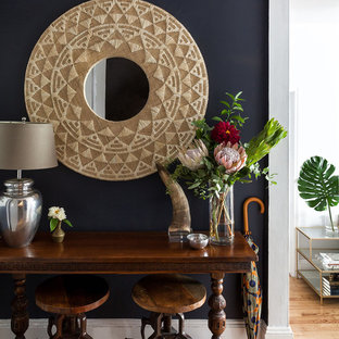 Small eclectic foyer photo in New York