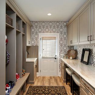 Entryway - traditional light wood floor entryway idea in Chicago with a white front door
