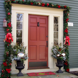 Design ideas for a traditional front door in New York with grey walls, a single front door and a red front door.