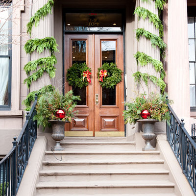 Inspiration for a timeless front door remodel in Boston with a medium wood front door