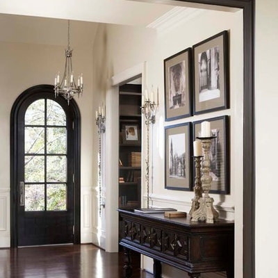 Large elegant dark wood floor single front door photo in Other with a black front door and white walls