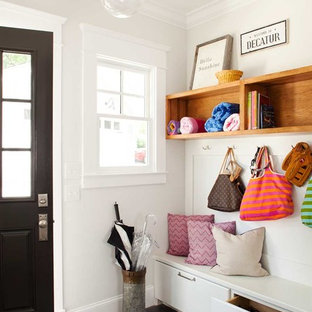 Inspiration for a small transitional dark wood floor entryway remodel in Atlanta with white walls and a black front door
