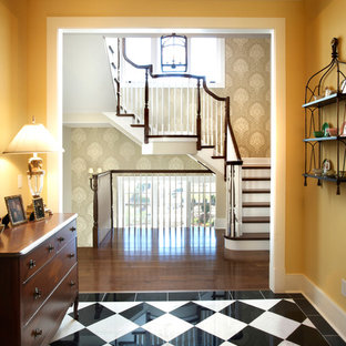 Example of a classic marble floor and multicolored floor foyer design in St Louis with yellow walls