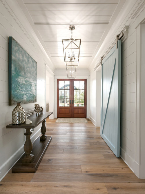 Example Of A Coastal Beige Floor Entry Hall Design In Charleston