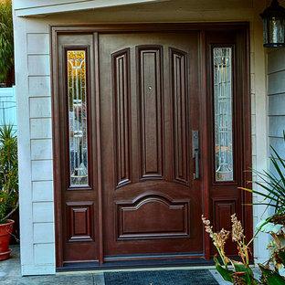Ispirazione per una grande porta d'ingresso classica con pareti blu, una porta singola e una porta in legno scuro