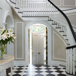 Inspiration for a mid-sized timeless marble floor and multicolored floor entryway remodel in New York with beige walls and a white front door