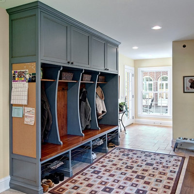 Inspiration for a large timeless mudroom remodel in Minneapolis