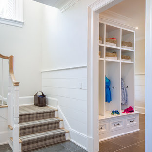 Inspiration for a mid-sized beach style limestone floor and gray floor entryway remodel in New York with white walls and a white front door