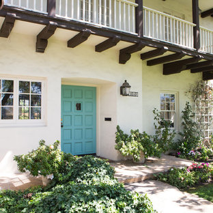 Tuscan entryway photo in Los Angeles with a blue front door