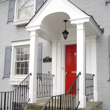 Classic White-Columned Portico and Wrought Iron Handrail