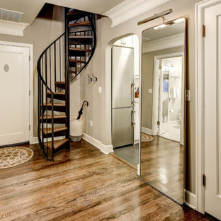 Example of a small classic dark wood floor entryway design in Seattle with beige walls and a white front door