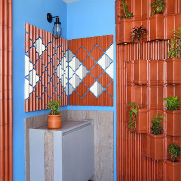 Clay sculpture & Brick pattern set the scene of natural medium in this apartment