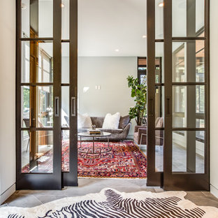 Entryway - large contemporary porcelain floor and gray floor entryway idea in Cleveland with white walls and a glass front door