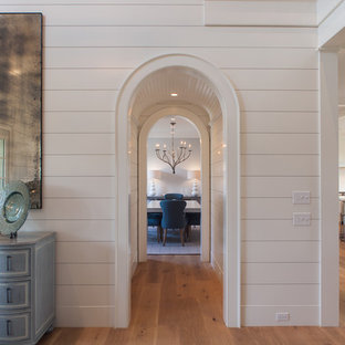 Inspiration for a beach style medium tone wood floor foyer remodel in Boston with white walls