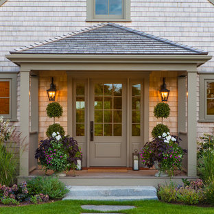 Inspiration for a beach style front door in Boston with a single front door and a brown front door.