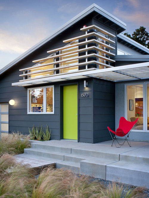 Example of a midcentury modern gray one-story concrete exterior home design  in San Francisco