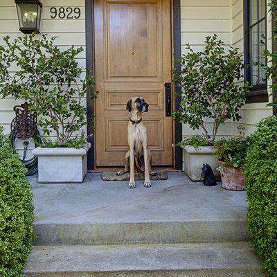 Entryway - traditional entryway idea in Seattle with a medium wood front door