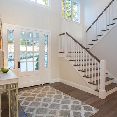 Country dark wood floor entryway photo in Seattle with beige walls and a glass front door