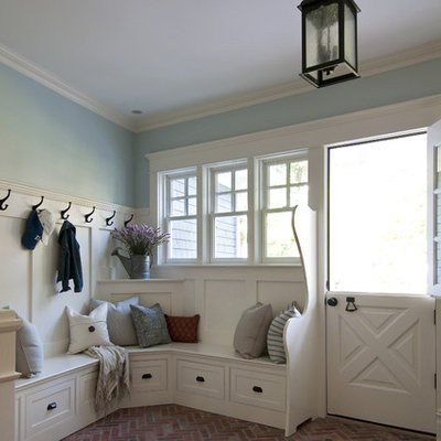 Inspiration for a timeless brick floor dutch front door remodel in Newark with a white front door
