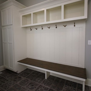 This is an example of a small arts and crafts mudroom in Chicago with grey walls, ceramic floors, a single front door, a white front door and grey floor.