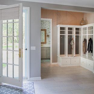 Entryway - coastal entryway idea in Minneapolis with gray walls and a glass front door