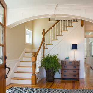Inspiration for a victorian entryway remodel in Providence with beige walls