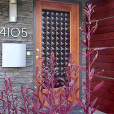 Modern Entry by Sculptural Glass Doors Inc