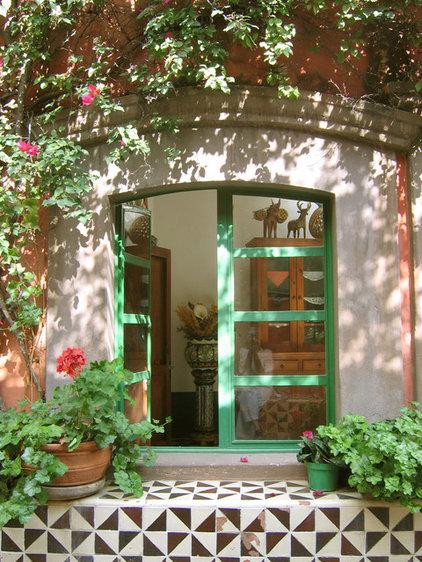 Mediterranean Entry by Larcade Larcade, Arch., Interior Design and Color