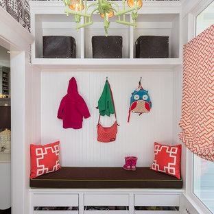 Mudroom - small transitional dark wood floor and brown floor mudroom idea in Atlanta with white walls