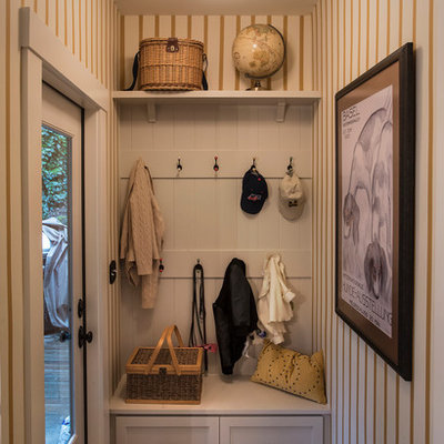 Example of a small classic entryway design in Portland with multicolored walls and a glass front door