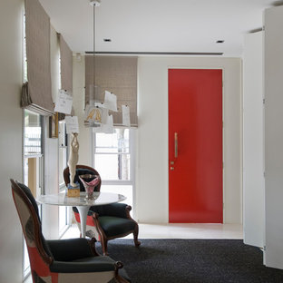 Design ideas for an eclectic entry hall in Sydney with white walls, carpet, a single front door, a red front door and black floor.