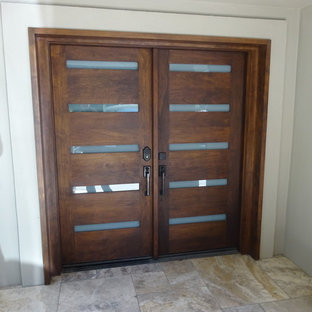Inspiration for a large contemporary marble floor double front door remodel in Los Angeles with white walls and a dark wood front door