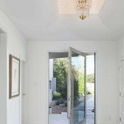 Example of a trendy entryway design in Austin with white walls
