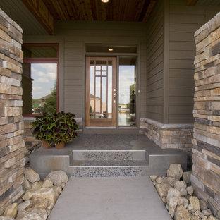 Entryway - contemporary entryway idea in Minneapolis with a glass front door
