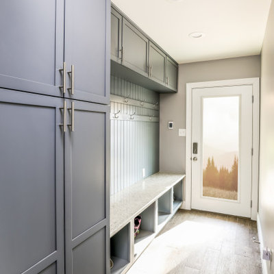 Entryway - mid-sized transitional light wood floor and beige floor entryway idea in DC Metro with gray walls and a white front door