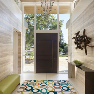Inspiration for a mid-sized contemporary entryway remodel in San Francisco with multicolored walls and a metal front door