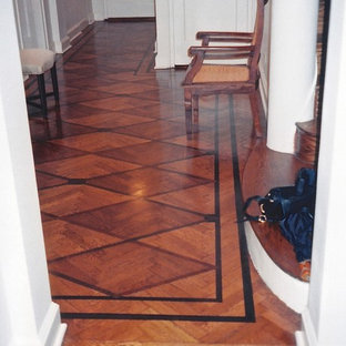 Inspiration for a mid-sized modern medium tone wood floor entryway remodel in New York with white walls and a white front door