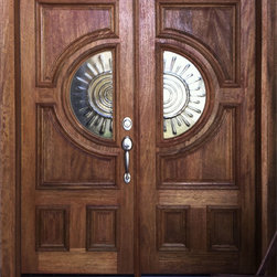 Double entry doors in Mahogany - Contemporary pair of Mahogany entry doors Model 676.  The doors are made of Mahogany with a sunburst design in cast glass.