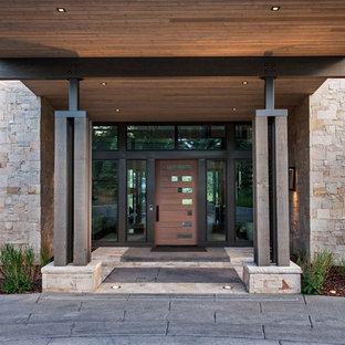 Inspiration for a large contemporary front door remodel in Salt Lake City with a dark wood front door