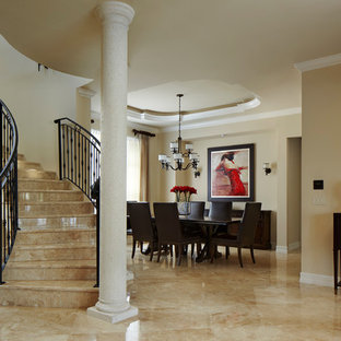 Large tuscan marble floor entryway photo in Miami with white walls and a dark wood front door